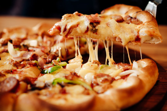 Pizza cheese and soft drink  on wooden table