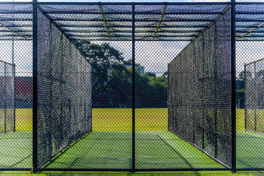 A cricket pratice net on green grass in Melbourne, Victoria, Australia