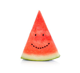 Slice of watermelon with seeds that make a smiling face.