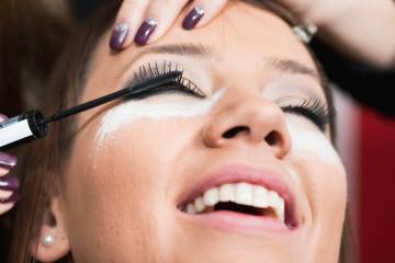 Make-up artist applying mascara