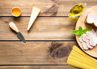 Italian carbonara ingredients on wooden background