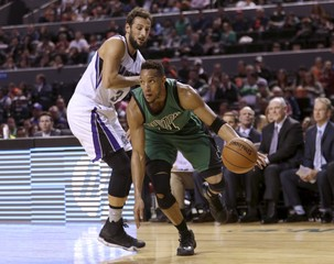 Evan Turner of Boston Celtics dribbles the ball past Marco Belinelli of Sacramento Kings during their NBA Global Games basketball game in Mexico City