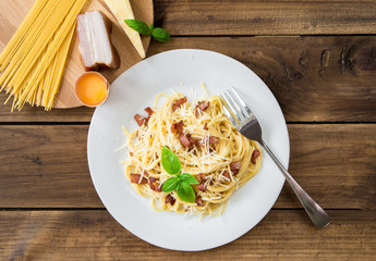 Pasta Carbonara. Spaghetti with bacon and parmesan cheese and ingredients