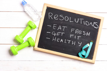 Chalkboard with resolutions: eat fresh, get fit and healthy