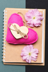 Heart in pink colour on beige eco notepad
