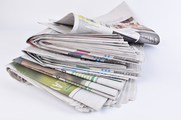 Stack headline business newspaper on white isolated background.