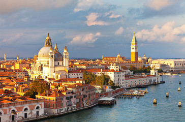 Venice. Top view of Dorsoduro district, Cathedral of Santa Maria della Salute, embankment Zattere and the Piazzetta San Marco, the Doge's Palace, Bell Tower Companile in the rays of the setting sun