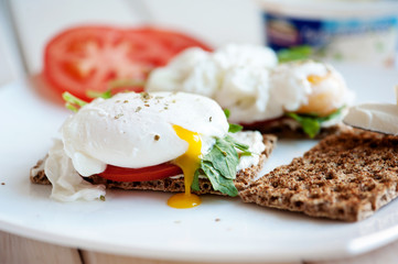 Poached eggs with watercress on toast