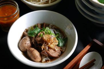Thai noodle blood soup with pork and pork balls, delicious boat noodle, boat noodle