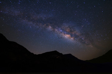 Beautiful milky way  galaxy over moutain on a night sky before sunrise.