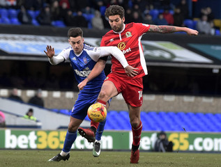 Blackburn's Charlie Mulgrew in action with Ipswich's Tom Lawrence