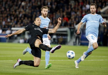 Paris St Germain's Ibrahimovic challenges Malmo's Bengtsson and Arnason during their Champions League Group A stage match at the Parc des Princes stadium in Paris