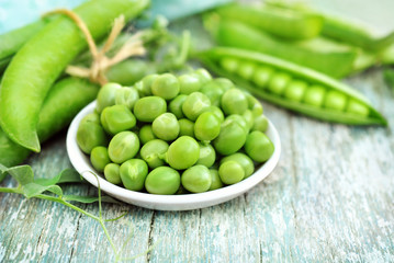 Fresh harvested green peas with pods