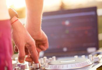 Dj mixing music outdoor.