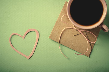 Love letter, envelope and pink cup of coffee. Valentines card. Horizontal, flat lay