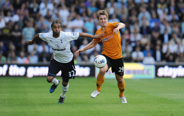 Wolves' Kevin Doyle (L) and Tottenham's Benoit Assou Ekotto in action