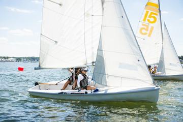 Teenagers sailing on boat