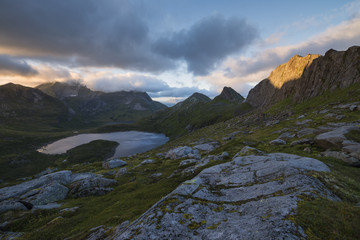 Fagerdalen valley scenery with lake and mountains at sunset