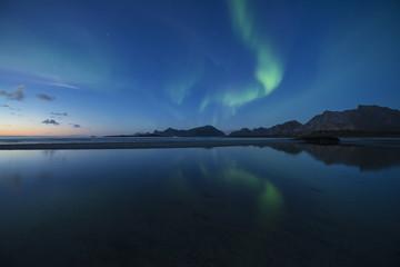 Northern lights shining over Ytresand beach