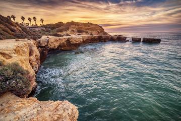 Algarve, Portugal: rocks in the coast of Albufeira at sunrise