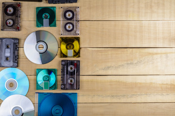 Musical cassette discs lie on a wooden table