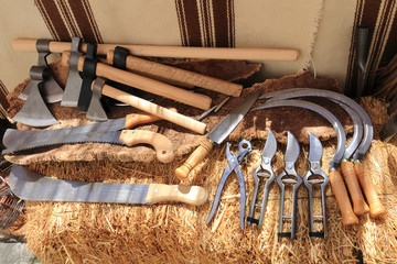 Agricultural tools exposed on a bale of hay