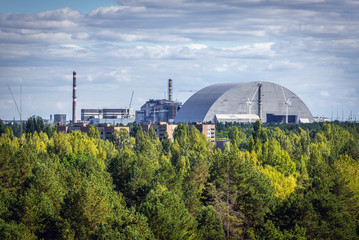 Aerial view of Chernobyl Exclusion Zone, Ukraine. Chernobyl New Safe Confinement on background