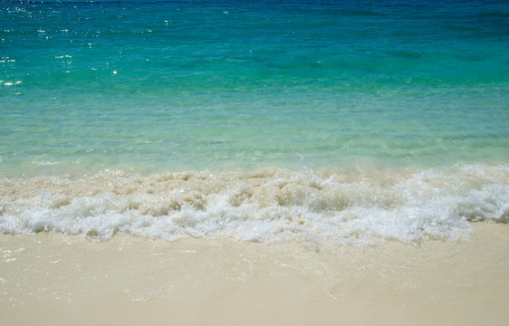 The beach with turquoise sea in tropical island