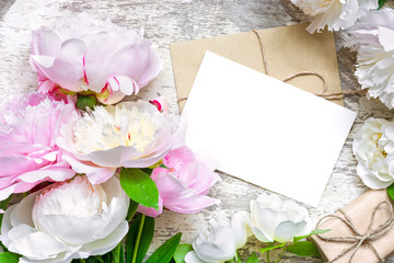 blank greeting card and envelope with pink and white peonies and roses and gift box