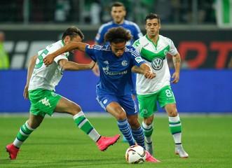 Wolfsburg's Traesch challenges Schalke 04's Sane during their Bundesliga first division soccer match in Wolfsburg
