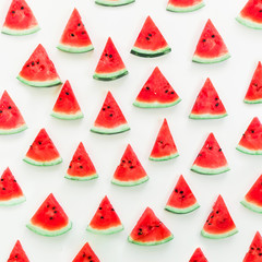 Pattern made of tasty slices watermelon on white background. Flat lay. Top view. Summer pattern