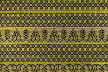 Dark brown and green background with geometric patterns
