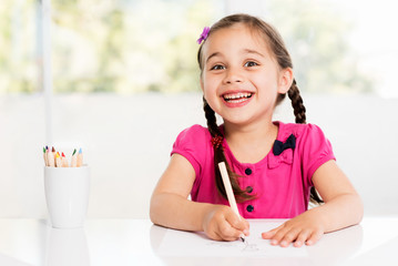 Little Girl Is Drawing Picture At Home