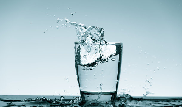Water splash in glass. Drinking water concept