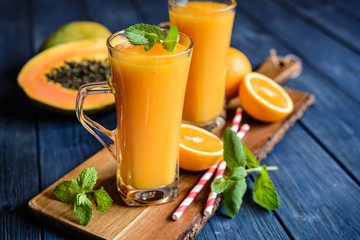 Healthy papaya, orange and mango smoothie