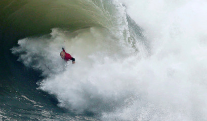 Allport rides a wave during the Cape Fear surfing tournament in heavy seas off Sydney's Cape Solander in Australia