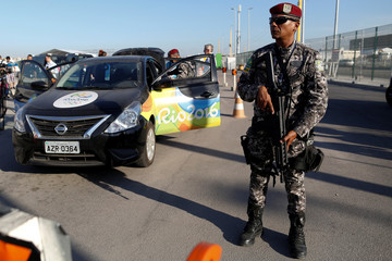 National Force soldiers check a car at the Rio 2016 Olympic Park in Rio de Janeiro