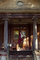 Girl standing on old house balcony