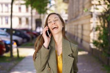 Young woman laughing at an amusing joke