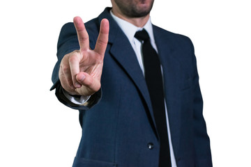 Young businessman in jacket and white shirt shows gesture Victory with two fingers. Business concept, focus on hand. V sign victory.