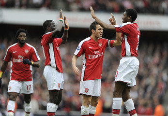 Arsenal's Abou Diaby (R) celebrates after scoring his sides first goal