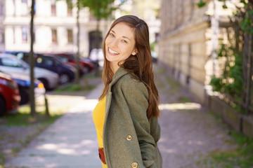 Happy friendly woman walking in town