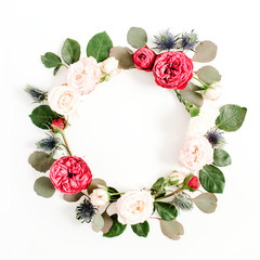 Round frame wreath made of red and beige rose flower buds, eucalyptus branches and leaves isolated on white background. Flat lay, top view. Floral background concept.