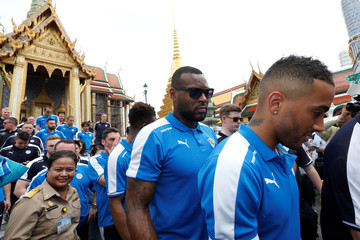 Leicester City soccer club's captain Wes Morgan walks with his teammates during a visit to the Emerald Buddha temple in Bangkok