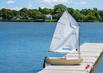 small sailboat on a wooden dock