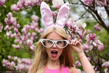 girl with funny glasses, bunny ears and open mouth