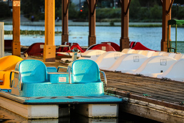 Peddle boats at dock of lake