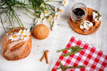 Coffee Cup, cracker, cookie, biscuit, chamomile flowers on a wooden table.