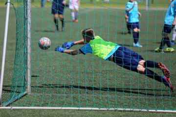 A goalkeeper throws the ball