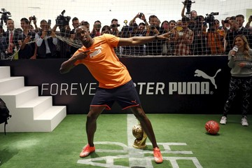 Jamaican sprinter Usain Bolt gestures during an event arranged by his sponsors Puma in Mexico City
